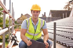 Builder Working On Roof Of New Building ** Note: Soft Focus at 100%, best at smaller sizes